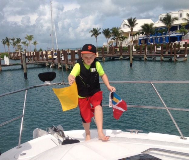 (2014) Ryan swapping the quarantine flag & courtesey flag, West End Bahamas