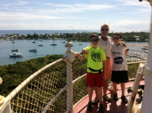 Ronan, Theresa & Ryan atop the Hope Town Light House with the Pilots Discretion in the harbor in the background
