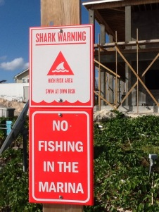 """Shark Warning"" sign at Flying Fish Marina, Long Island, Bahamas"