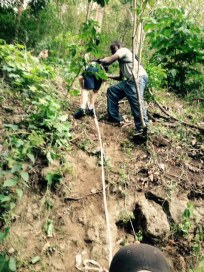 Grenada Hash hike - the boys scaling the rope obstacle