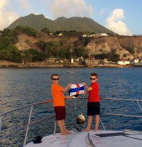 R&R hoisting the courtesy flag in St. Eustatia in front of the Quill volcano