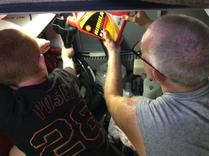 Ryan & Randy changing the oil in the generator
