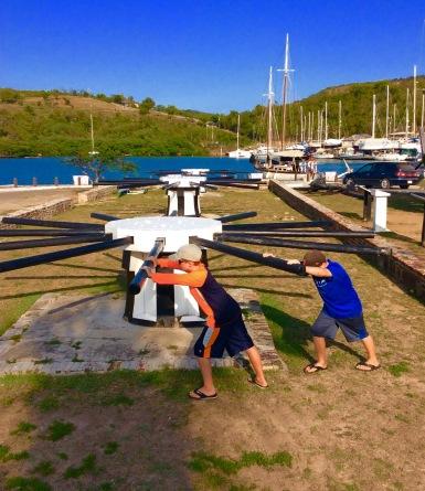Ryan & Ronan pushing the replica capstans (used to careen British naval vessels), Nelson's Dockyard, Antigua