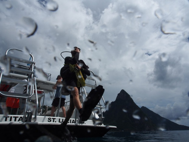 Long step into the water, diving in St. Lucia