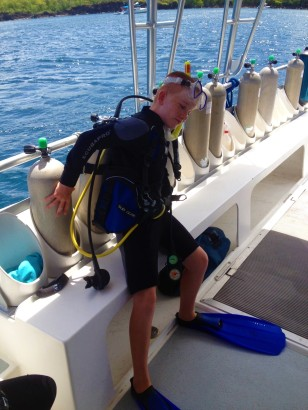 Retrieving the dive tank from the rack, St. Lucia