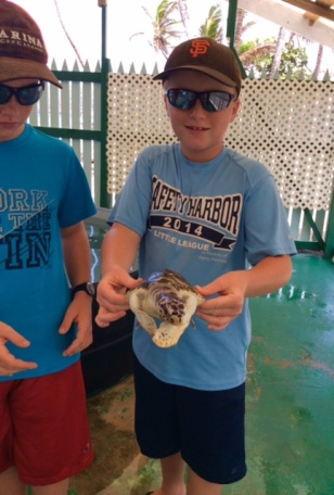 Ronan holding the endangered Hawksbill turtle at the turtle sanctuary in Bequia
