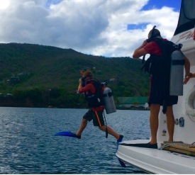 Ryan stepping in to dive the boat with Randy, Bequia