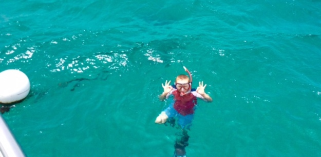 Ronan giving the 'OK' on the mooring ball, Baradol Island, Tobago Cays