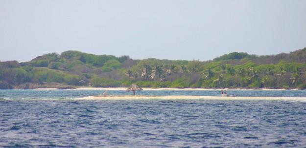 Thatched hut on sand bar entering cut between Petit St. Vincent & Petite Martinique