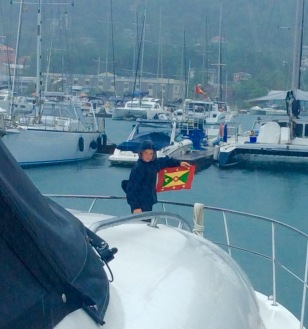 Ryan hoisting the courtesy flag, Grenada