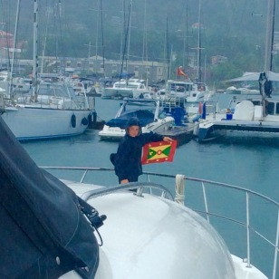 Ryan hoisting the courtesy flag, Grenada