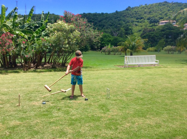 Ronan playing croquet, Mount Cinnamon Resort, St. Georges, Grenada