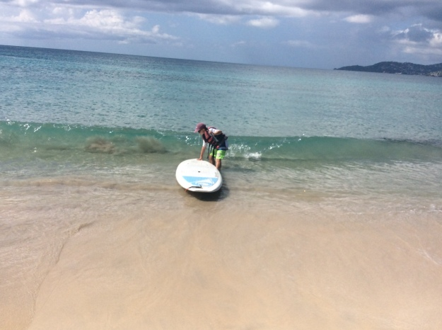 Ryan tackles the stand up paddle board, Mount Cinnamon, Grand Anse Beach, Grenada