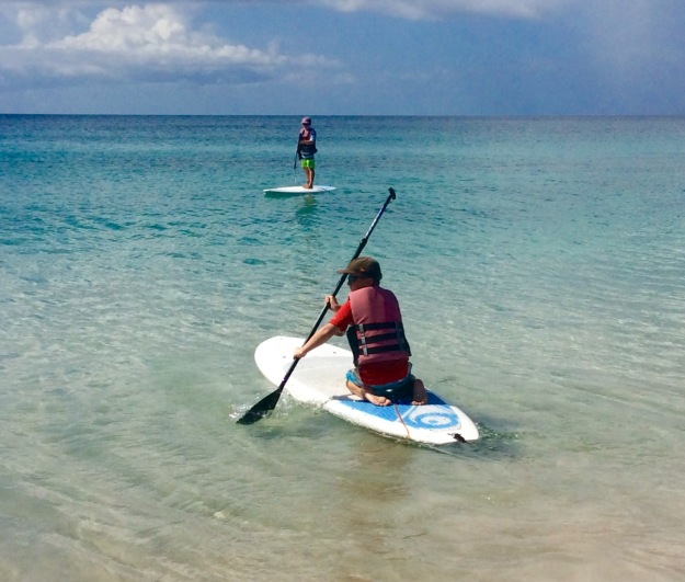 Ronan paddles out to join his brother, Mount Cinnamon, Grand Anse Beach, Grenada