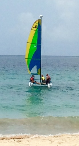 Ronan and Ryan taking Randy out on the Hobie Cat, Mount Cinnamon Resort, St. George's, Grenada
