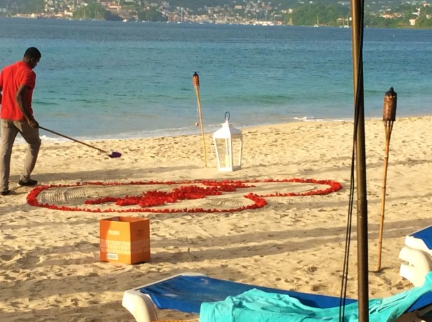 Putting the finishing touches on the flower pedal heart for the private beachside-waterfront-sunset, dinner for two, Mount Cinnamon Resort, St. George's, Grenada