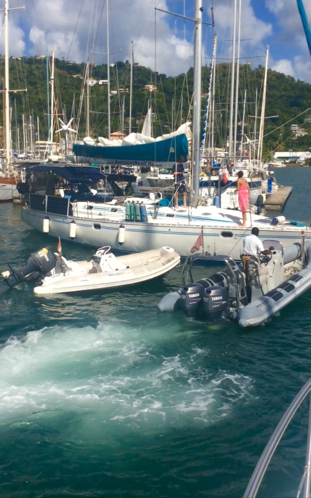 Port Louis Marina staff wrestling with arriving sailboat as the winds pick up