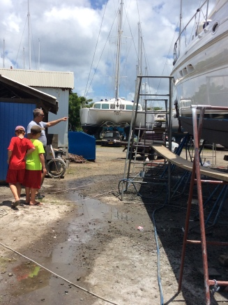 Ryan, Ronan and Randy inspecting the boat maintenance projects