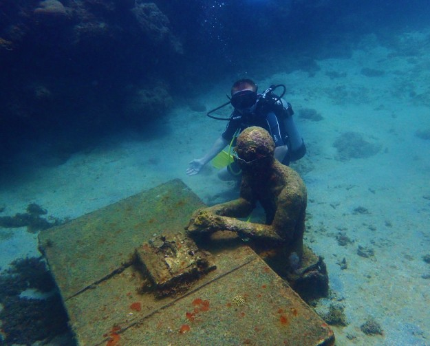 (Ryan) Typing at the desk, Underwater Sculpture Park, Molinere Bay, Grenada