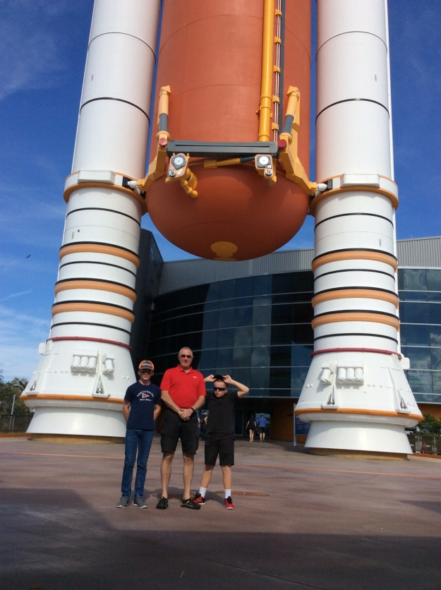 Ryan, Randy, & Ronan at the feet fo the Atlantis Rocket, Cape Canaveral, 12/17