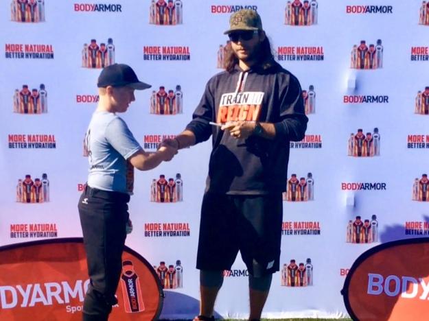 Ronan shaking hands with Brandon Crawford (Jan. 2018)