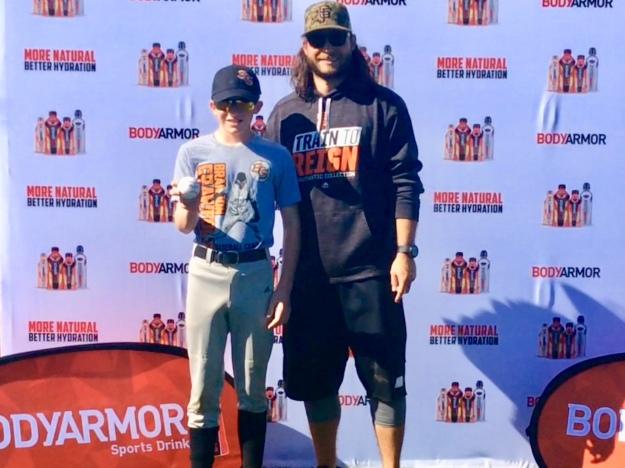 Ryan with his baseball signed by Brandon Crawford (Jan. 2018)