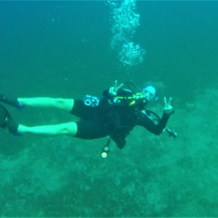 Theresa diving the Lesleen M Wreck in St. Lucia (Jan. 2018)