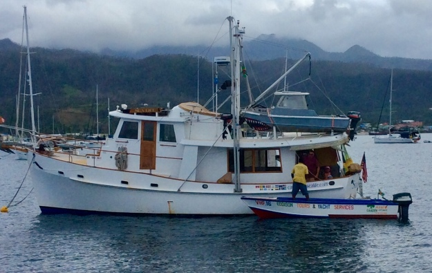PAYS member offering services (tours, food, beverages, trash removal) to cruiser, Portsmouth, Dominica