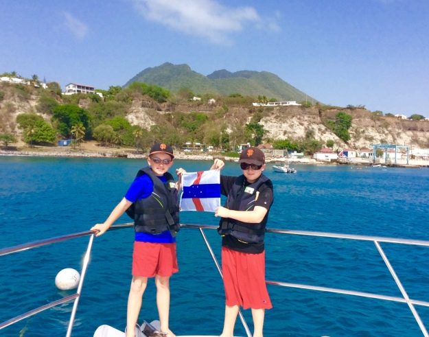 Ryan & Ronan hoisting courtesey Statia flag (March 2015)