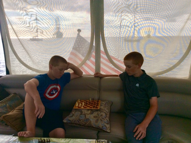 Ronan & Ryan playing chess on the bridge, Sailing Cruise Ship Club Med 2 off our stern, Deshaies, Guadeloupe (2018)