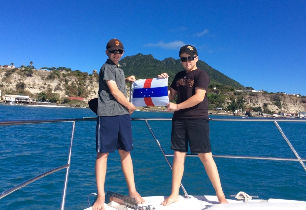 Ryan & Ronan hoisting courtesey Statia flag (March 2018)