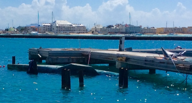 Damaged docks, sunken vessel, missing roofs, Fort Louis Marina / Marigot Bay St. Martin (March 2018)