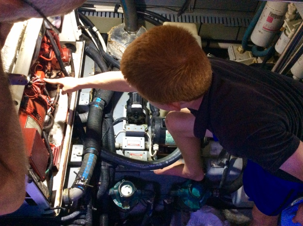 Ryan pointing to the old oil filter