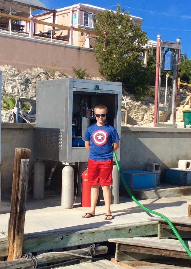 Ronan assisting with the fueling at Southside Marina, Providenciales Turks & Caicos