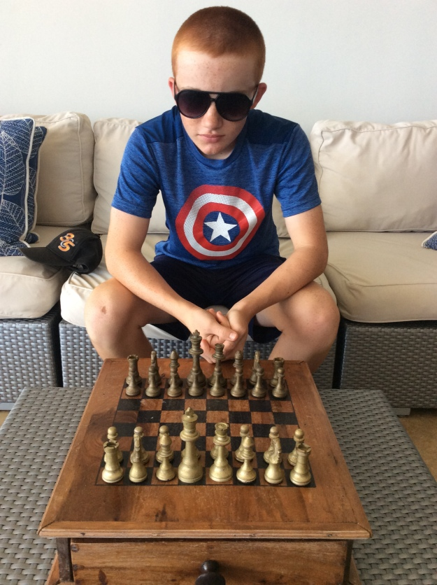 Ryan ready for chess, Puerto Bahia Marina, Samana, Dominican Republic