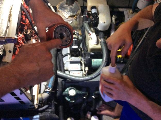 Dip finger in oil to lube ring of new oil filter