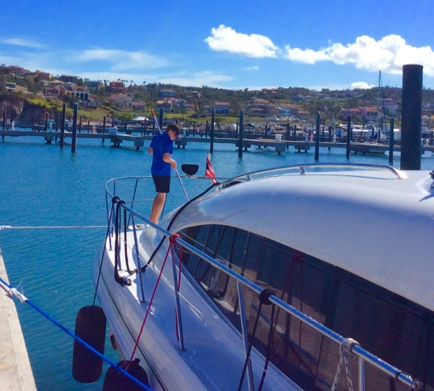 Ryan washing the salt off the boat, The Yacht Club Marina at Palmas del Mar, Puerto Rico