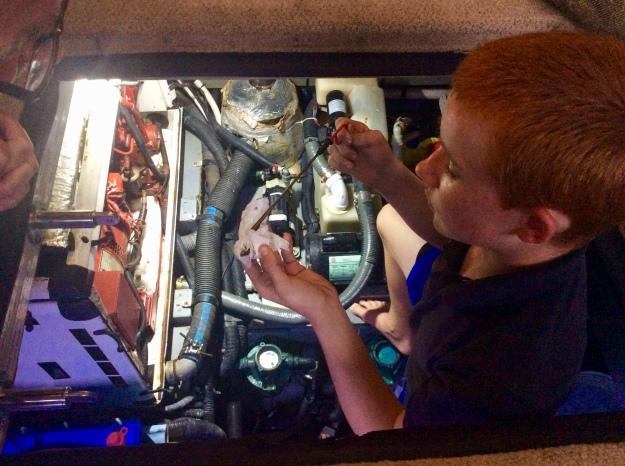 Ryan checking the dip stick oil level