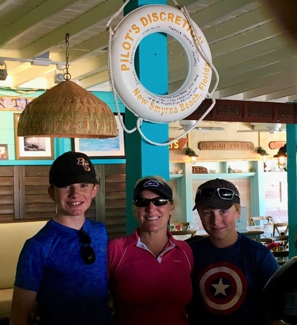 Ryan, Theresa & Ronan in front of the Pilot's Discretion life ring, Staniel Cay Yacht Club, Exumas, Bahamas (May (2018)