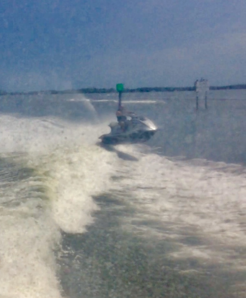 Jet skier in our wake
